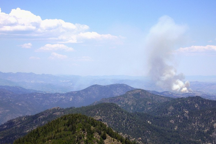 A fire is  visible from  Connors' lookout location in the Gila National Forest.