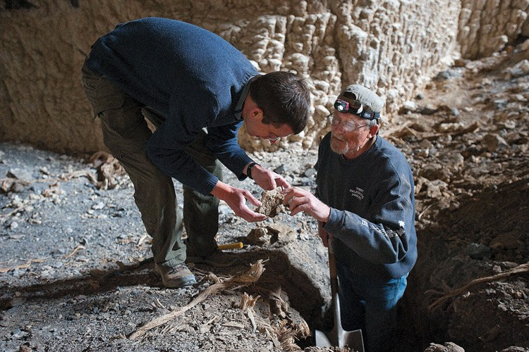University of Minnesota geologist David McGee and University of Texas archaeologist David Madsen study a sample found in Cathedral Cave.