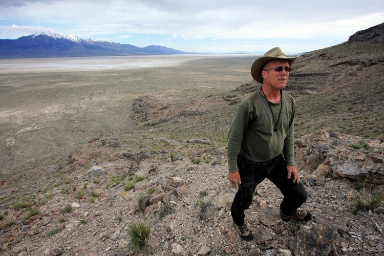 Geologist Jay Quade in Utah's Silver Island Range. Behind him is the basin that held Lake Bonneville 14,000 years ago.