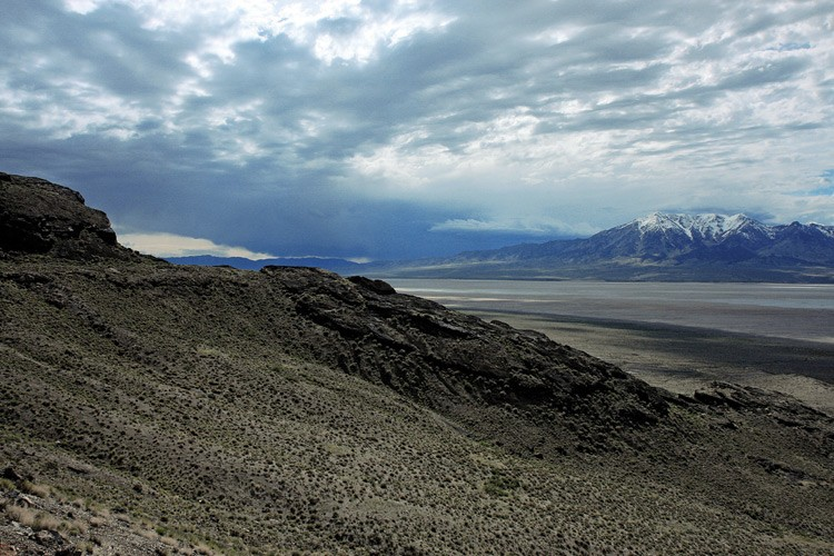 An ancient shoreline left by Lake Bonneville 16,000 years ago lies between the northwest slopes of the Silver Island Range, in the foreground, and Pilot Range.