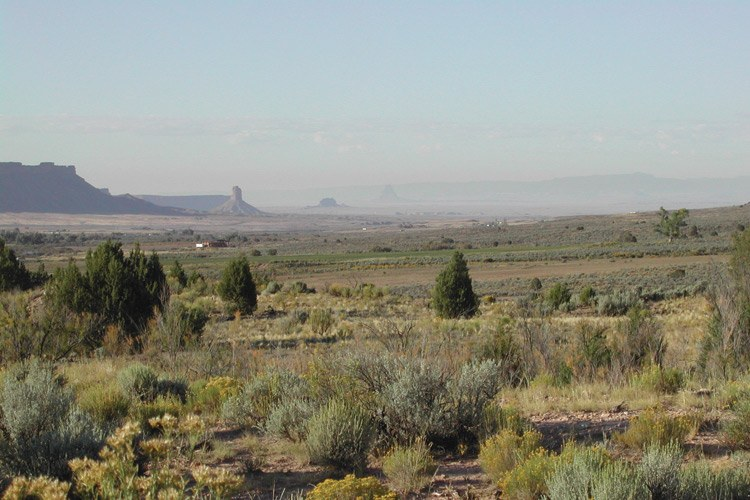In late September, the view from Yucca House National Monument, just west of Mesa Verde National Park in southwestern Colorado, was obscured by haze that hung low in the Montezuma Valley. A faint outline of Shiprock is visible in the center of the photo.