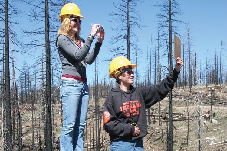 Greenville High School students Haley Fox and Sidney Deschenes take snapshots from an established photo point at the site of the Moonlight Fire.