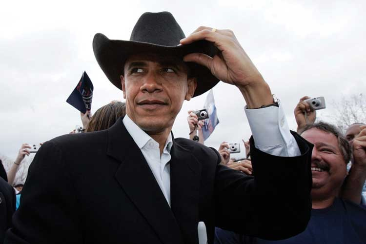 President Barack Obama, looking slightly uncomfortable in a cowboy hat a supporter handed him during a campaign stop in 2007.