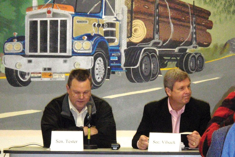 Agriculture Secretary Tom Vilsack (right) and U. S. Sen. Jon Tester, D-Mont., listen to public comments at a meeting on healthy forests in Deer Lodge, Montana, last March.
