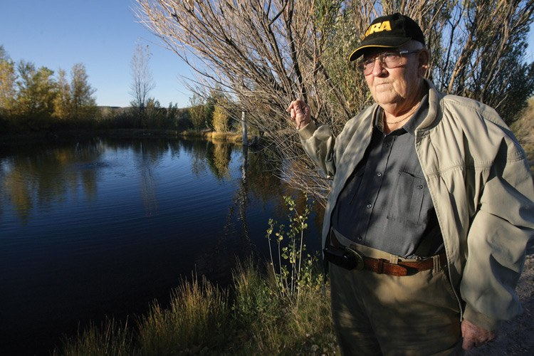 "Jerry Nivens stands near what he refers to as ""my little miracle in the desert,"" a naturally occurring pond that is fed by ground water surrounded by arid desert. The pond is located less than a mile away from a proposed dairy site."