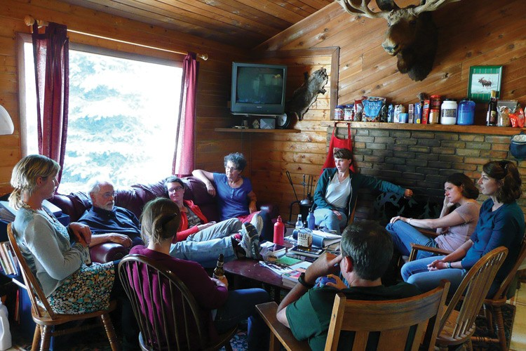 Kicking back at the Texan Resort's Moose Cabin, the Hardrock Revision team discusses community issues with T. Allan Comp, second from left, of the U.S. Office of Surface Mining.