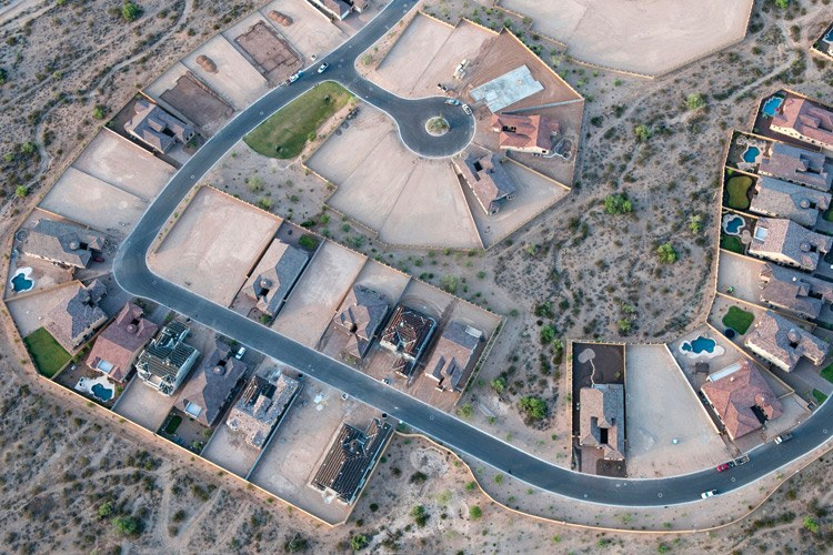 Empty lots make up half of a desert subdivision near Phoenix, Arizona.
