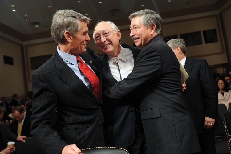 Sen. Ken Salazar, D-Colo., center, then the nominee for Secretary of the Interior, is greeted by his brother Rep. John Salazar, D-Colo., right, and Sen. Mark Udall, D-Colo., before his confirmation hearing with the Senate Energy and Natural Resources Committee, Jan. 15, 2009.