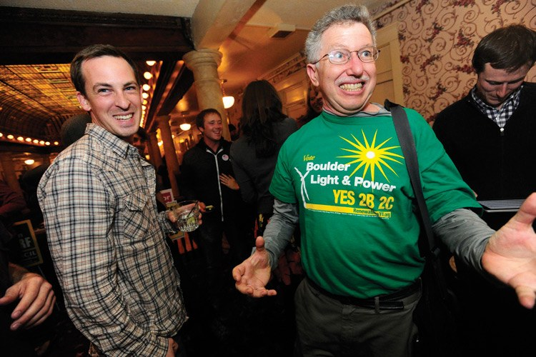 On election night at Hotel Boulderado, Ken Regelson (right) of Citizens for Boulder's Clean Energy Future, and Steve Fenberg, executive director of New Era Colorado, celebrate results showing Measure 2C pulling ahead. The measure allows Boulder to create a municipal electric utility if costs allow.