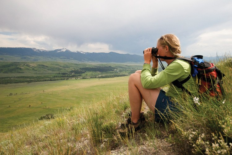 Ostlind scans the pronghorn summer range from Blacktail Butte in Grand Teton National Park. The pronghorn raise their fawns in the hayfields and sagebrush below. In the distance is the mouth of the drainage the migrating pronghorn follow into the Gros Ventre Mountains.