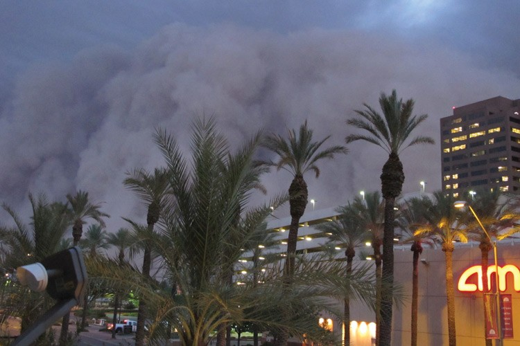 "A dust storm known as a ""haboob"" rolls into Phoenix in July, bringing strong winds and reducing visibility."