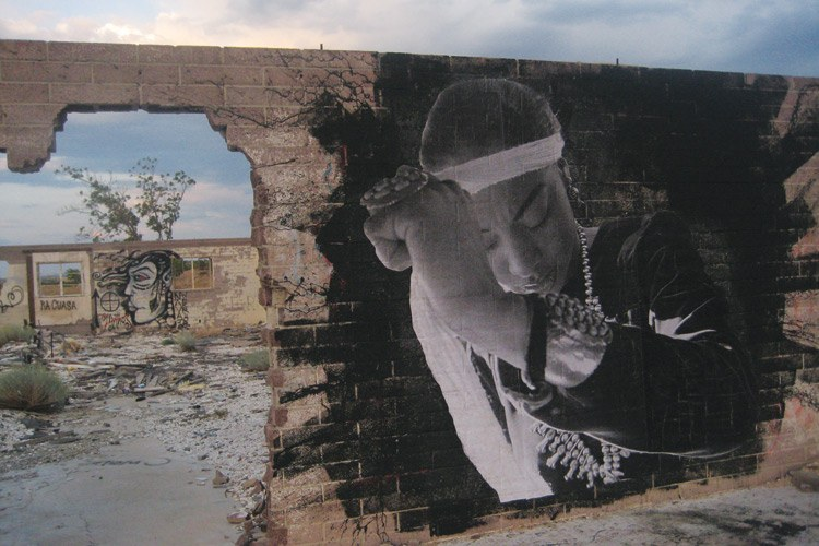 Artist and photographer Jetsonorama wheat-pasted an image of Radmilla Cody from her Miss Navajo days at the old Cow Springs Trading