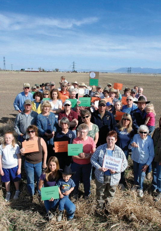 "Montana residents are fighting a proposed plan by NorthWestern Energy to install a new power transmission line, with towers taller than those on existing lines, starting in Townsend. Their signs read ""Concerned Citizen"" and ""A Clean Sweep: No substation; no transmission lines."""