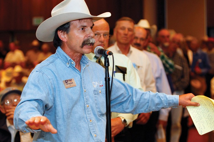 Bill Bullard, surrounded by hundreds of cattlemen and feedlot owners, addresses U.S. Department of Agriculture and Department of Justice officials at a conference on competition in the livestock industry