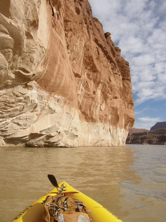 The river disappears into Lake Powell, where the bathtub ring shows the lake level during highwater years.