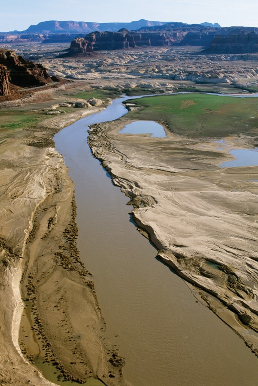 The silt-laden Colorado River was revealed above Hite Marina during the drought year of 2003, with the lake level down 100 feet.