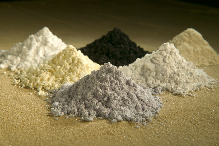 Some rare earth oxides, clockwise from top center: praseodymium, cerium, lanthanum, neodymium, samarium and gadolinium.