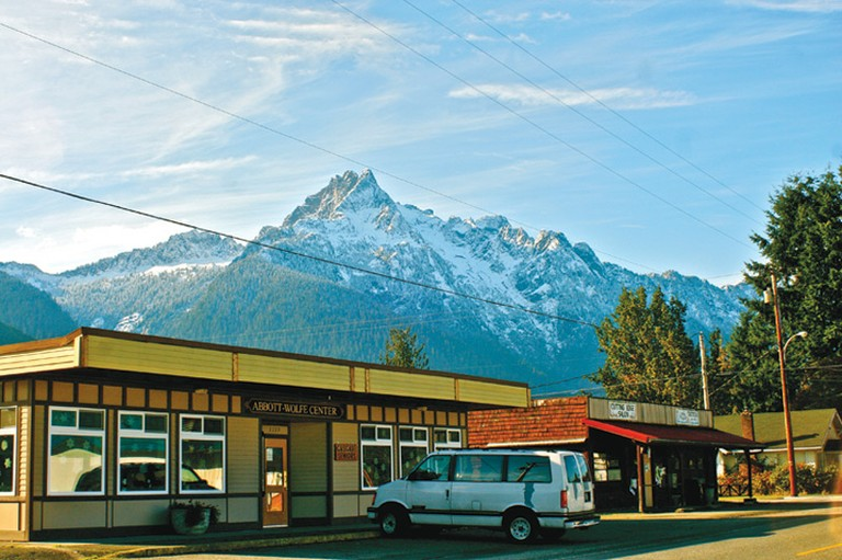 Whitehorse Mountain towers over 6,000 feet above Darrington, Washington, where a struggling timber mill is still the major employer.