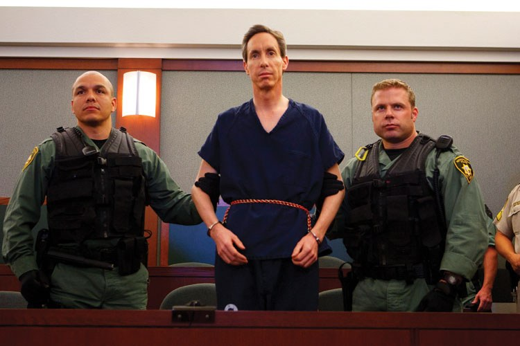 Handcuffed and flanked by Las Vegas SWAT officers, FLDS leader Warren Jeffs appears before a Las Vegas judge in 2006, shortly after his arrest on a Nevada highway. He was extradited to Utah to face charges related to rape.