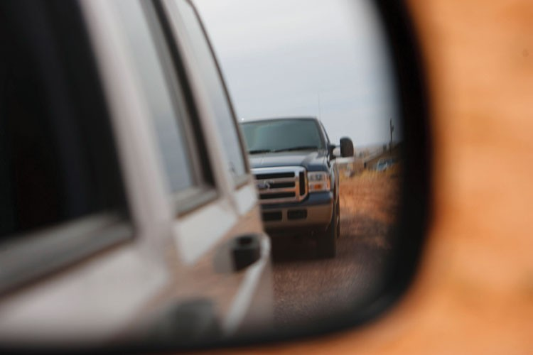 A truck with heavily tinted windows follows Mohave County investigator Gary Engels through Colorado City in March 2006 -- in