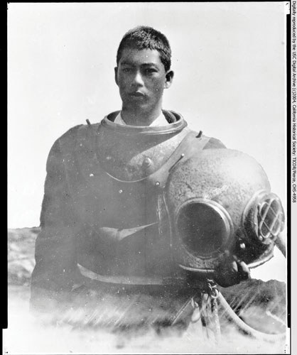 A Japanese-American abalone fisherman in a deep-sea diving suit at the fisheries at White's Point, San Pedro, circa 1910.