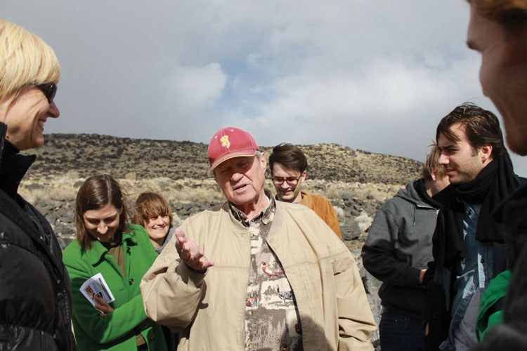Bob Phillips, the foreman of the crew that actually built the Spiral Jetty, tells his story to a group of art historians and architects from Switzerland.