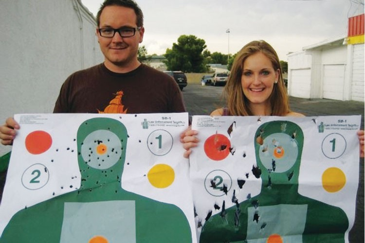 Ian Lyman and Marian Lyman Kirst with their targets at The Gun Store in Las Vegas.