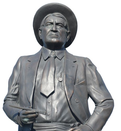 Montana towns memorialize Charles M. Russell through place names and statues like this one in Chinook.