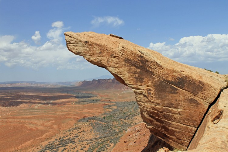 A sandstone formation juts out from Comb Ridge, a huge sandstone wave that stretches from the Abajo Mountains in Utah to Kayenta, Ariz.