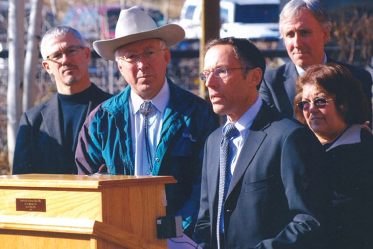 "Outdoor Industry Association CEO Frank Hugelmeyer, left, and Peter Metcalf (at the podium) flank Interior Secretary Ken Salazar at a press conference announcing Interior's new ""wild lands"" protection policy. Six months later, under attack from Republicans, the policy was rescinded."