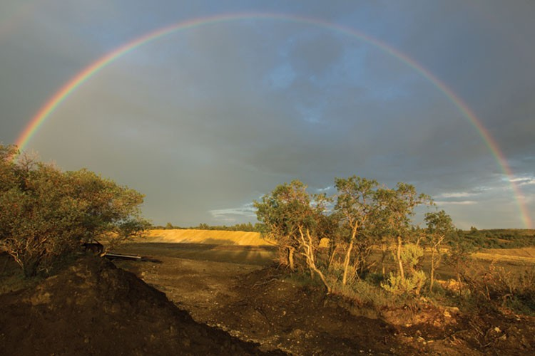 A rainbow frames a tailings pile, part of Calgary-based U.S. Oil Sands' tar sands project at PR Spring atop U