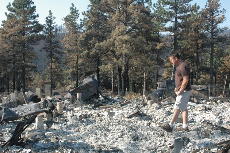 Dave Cantor walks through the ashes of his home in the wildland-urban interface near Fort Collins, Colorado. His was among the 259 homes that burned to the ground in the High Park Fire in early June. A second Colorado wildfire, the Waldo Canyon, consumed another 350 homes weeks later.