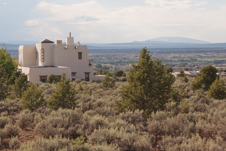 A new home within the 22,000-acre Cristobal de la Serna Land Grant, which the King of Spain gave to a prominent Spanish soldier in the early 1700s. Many Taos Hispanos believe that the land still belongs to a handful of heirs who trace their ancestry back to the original settlers.