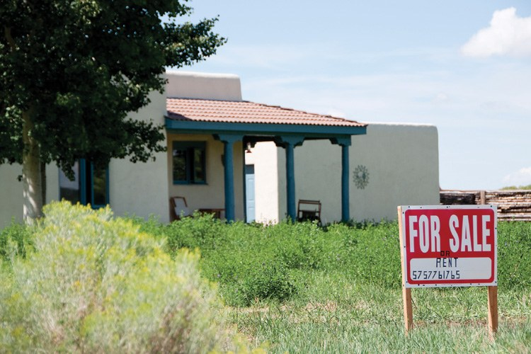 A house for sale on the Arroyo Hondo Land Grant in Taos, where Hispanos have filed warranty deeds on traditional lands that have tied up real estate transactions. Buyers showed no interest in this property, so the owners are now hoping to rent it.