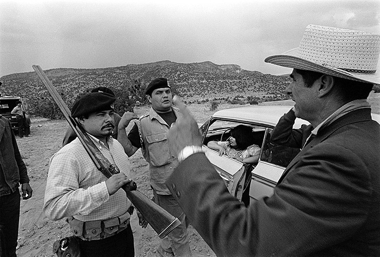 Reies López Tijerina, right, with some California Brown Berets, during a four-day Alianza convention near Abiquiu Dam in 1969, where Tijerina announced plans for making a citizen's arrest of New Mexico Gov.