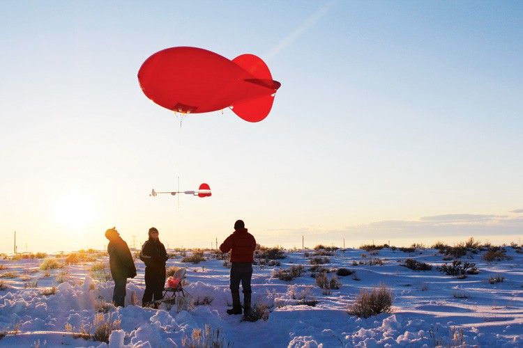 Researchers with the Uintah Basin Winter Ozone Study launch a blimp-shaped balloon in early 2011 to take air quality samples at various altitudes.