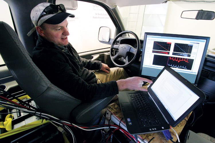 National Oceanic and Atmospheric Administration senior research associate Jon Kofler shows air quality readings from inside the ozone study's testing van at Utah State University Uintah Basin in Vernal in February 2012.
