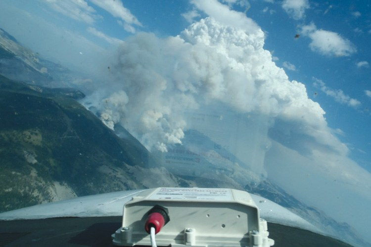 The Rapid Creek Fire, started by lightning July 29 in Montana's Bob Marshall Wilderness, grew rapidly from a quarter acre to more than 1,000 acres, before meeting up with the Elbow Pass Fire nearby. Both are being suppressed.