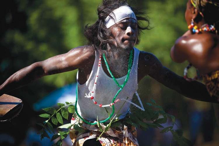 Members of the extended Tarlesson family perform an African war dance during the cultural festival in Guinda.