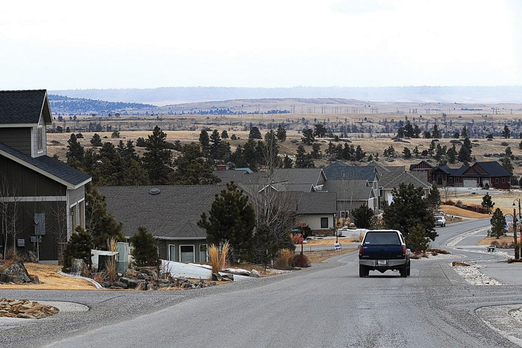Homes dot the hillside on the Rehberg Ranch Estates development, where many dozens of lots have been sold so far, and the plan calls for a total of 1,200 housing units.