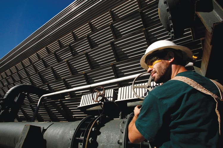 Jason Tapia, power plant operator, checks cooling tower valves at the Calpine Corp. thermal energy power plant in Middletown, California.