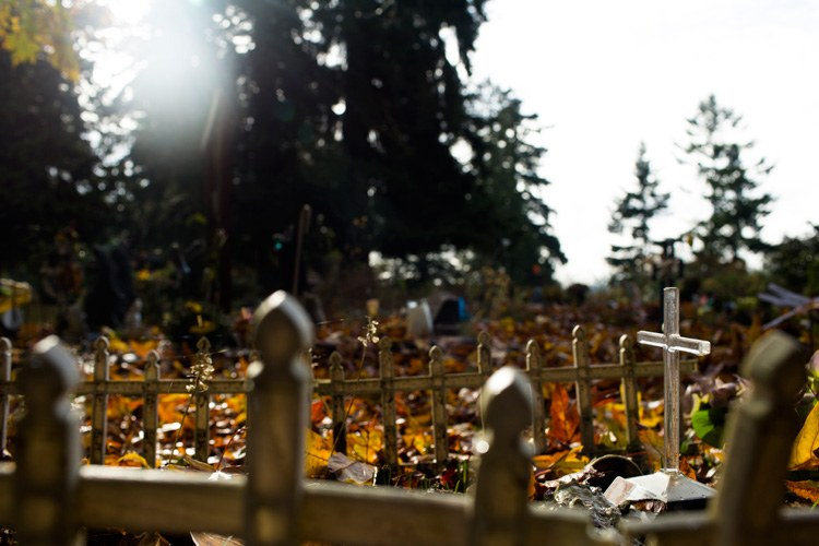 Offerings and plastic crosses placed on S'Klallam graves glint in the afternoon light on the Port Gamble S'Klallam Tribe reservation in Washington.