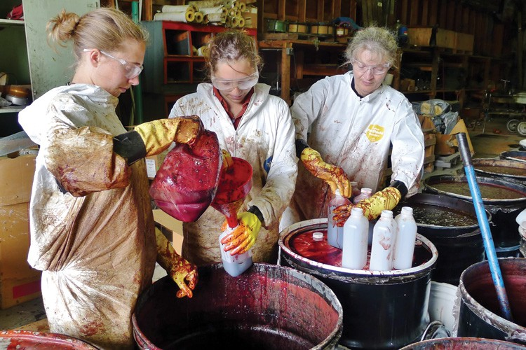 "Kate Kendall (far right) and project technicians Christine de Caussin and Katie Spendel concoct ""grizzly bear soup."""