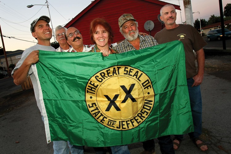 State of Jefferson supporters pose for a photo with their state flag in Yreka, California.