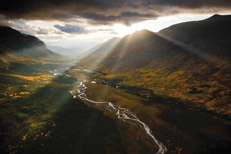 Sunlight peeks through the clouds above Todagin Creek in the Skeena Mountains, British Columbia, Canada, where a number of new mines threaten the pristine watershed.
