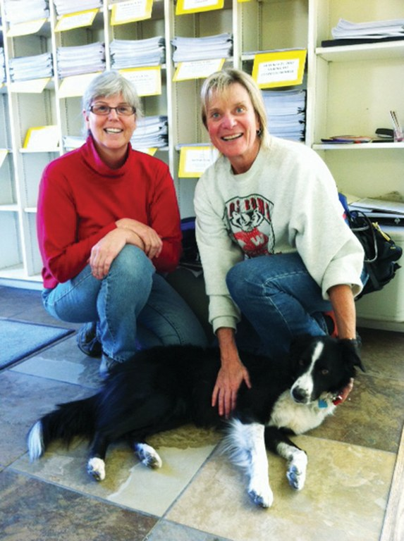 Ann Dee Allen, left, and her high school pal Lisa Eckert, right, stopped by the office with Lisa's dog.