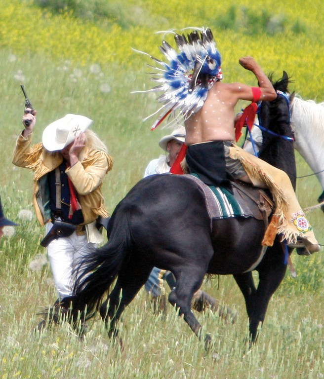 "Williams flinches from a ""fatal"" blow during a 2011 re-enactment of the Battle of the Little Bighorn near Hardin, Montana."