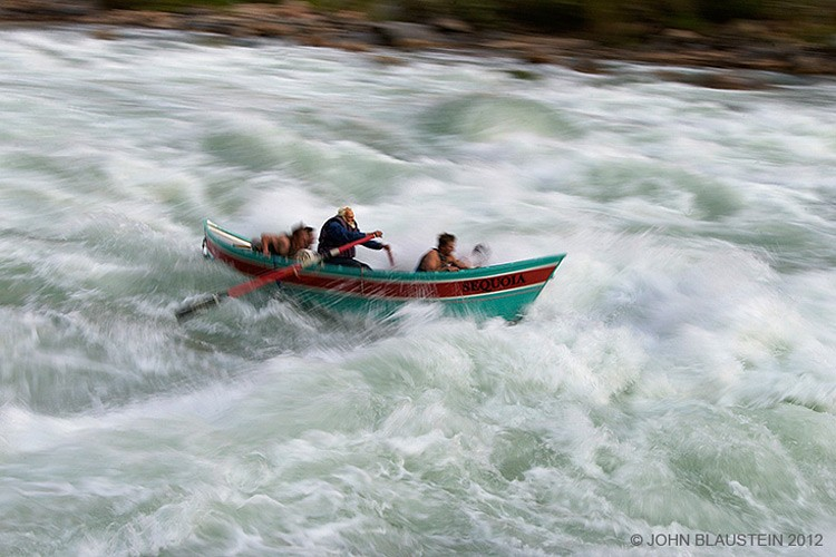 Martin Litton runs a rapid in the dory Sequoia.