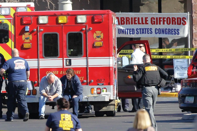 Sheriffs' deputies, the FBI and emergency medical personnel work the scene at the Safeway parking lot following the shooting of Arizona Congresswoman Gabrielle Giffords and 18 others in January 2011. Six died.