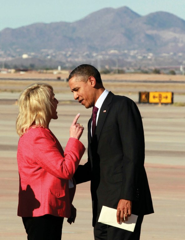 Gov. Jan Brewer shakes a finger at President Obama last month during his campaign stop in Phoenix.